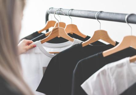 woman-choosing-t-shirts-during-clothing-shopping-at-apparel-store-picjumbo-com