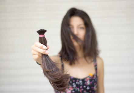 Young woman donating her hair