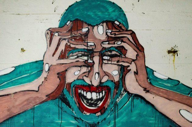 www.juicysantos.com.br - era só dor de cabeça - grafite de um homem com dor de cabeça